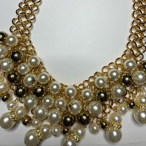 Gold toned and pearl bib necklace